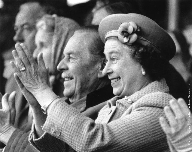 1985: Queen Elizabeth II applauds enthusiastically as her husband, Prince Philip, the Duke of Edinburgh, tackles the obstacle course for coaches at the Royal Windsor Horse Show