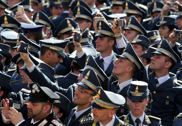 Italian Finance Police take pictures as Pope Francis leads a mass for the Armed Forces Jubilee in Saint Peter's Square at the Vatican, April 30, 2016. (Photo by Alessandro Bianchi/Reuters)
