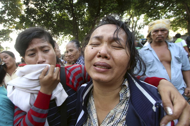 Family members cry outside at Adam Malik hospital as they wait for the bodies of victims of an Indonesian military C-130 Hercules transport plane that crashed into a residential area in the North Sumatra city of Medan, Indonesia, June 30, 2015. (Photo by Septianda Perdana/Reuters/Antara Foto)