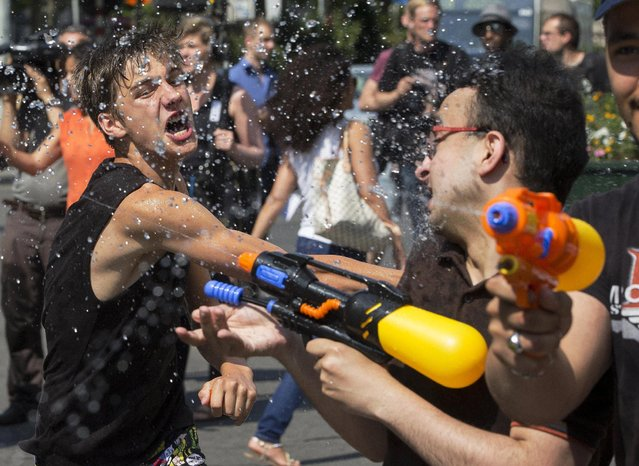 People take part in a giant water fight on a hot summer day in central Brussels, Belgium, July 3, 2015. (Photo by Yves Herman/Reuters)
