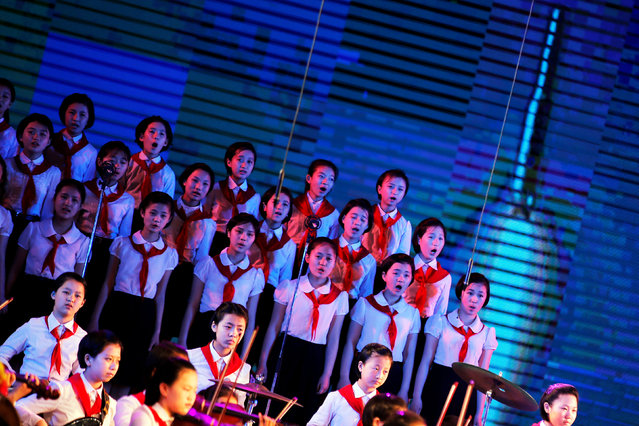 A rocket is projected on the screen as girls perform at the Mangyongdae Children's Palace in Pyongyang, North Korea May 5, 2016. (Photo by Damir Sagolj/Reuters)