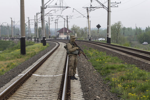 A Ukrainian soldier stands guard on the railway tracks near the town of Slaviansk in eastern Ukraine May 2, 2014. (Photo by Baz Ratner/Reuters)
