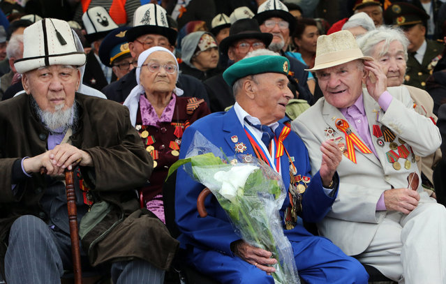 Kyrgyz World War II veterans take part in the Victory Day celebrations in Bishkek, the capital of Kyrgyzstan, 09 May 2016. Kyrgyzstan celebrates the 71st anniversary of the victory of the Soviet Union and its Allies over Nazi Germany in WWII. (Photo by Igor Kovalenko/EPA)
