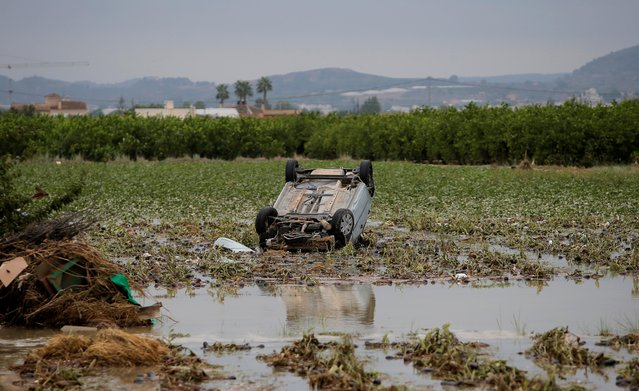 An overturned damaged car is stranded on a field after a flood caused by torrential rains in Orihuela, Spain, September 14, 2019. At least six people have been killed and some 3,500 evacuated in two days of torrential rains in southeastern Spain. (Photo by Jon Nazca/Reuters)