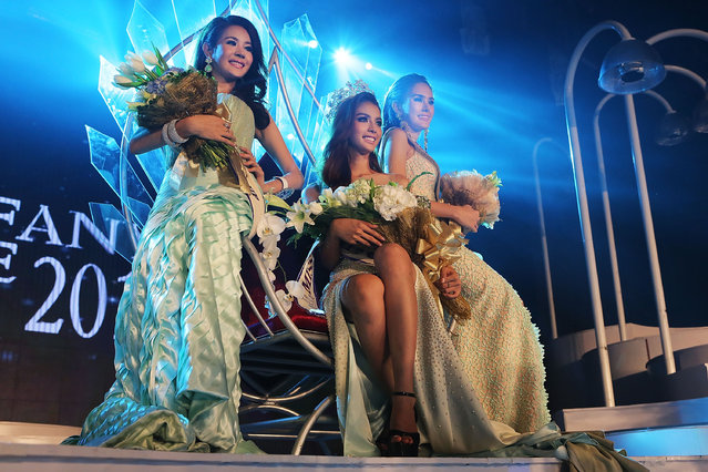 Nissa Katerahong, the winner of the Miss Tiffany's Universe transgender beauty contest, poses for pictures with the two runners up on May 2, 2014 in Pattaya, Thailand. (Photo by Taylor Weidman/Getty Images)