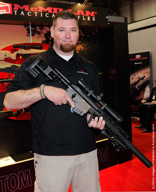 Jack Oliver with McMillan Firearms Manufacturing displays the company's new CS5 bolt action tactical rifle