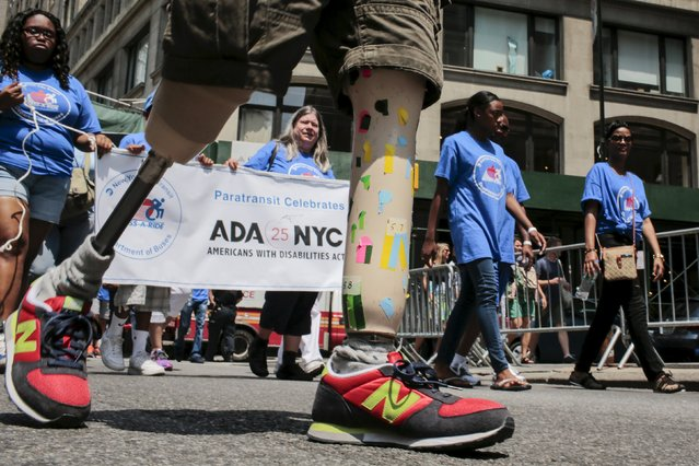 Donald Lee, 38, suffering from bilateral amputee, marches while taking part in the disability pride parade in New York July 12, 2015. (Photo by Eduardo Munoz/Reuters)