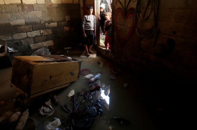 Palestinian children look at a shelter that was flooded during a rainstorm, in the northern Gaza Strip February 17, 2017. (Photo by Mohammed Salem/Reuters)