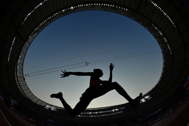 An athlete competes in the Women's Triple Jump Qualification at the 2019 IAAF Athletics World Championships at the Khalifa International stadium in Doha, Qatar on October 3, 2019. (Photo by Dylan Martinez/Reuters)