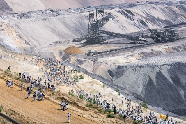 Activists climb into the Garzweiler open pit on June 22, 2019 in Nordrhein-Westfalen, Germany. The protests for more climate protection in the Rhineland continue. (Photo by Federico Gambarini/dpa/Keystone)
