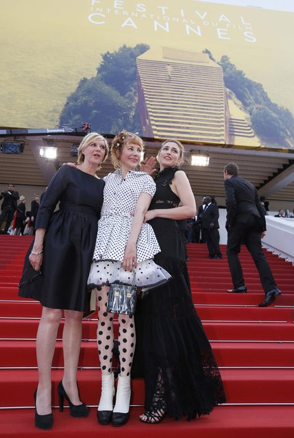 "French film producer and actress Julie Gayet (R) and actress Julie Depardieu (C) pose on the red carpet as they arrive for the screening of the film ""La fille inconnue"" (The Unknown Girl) in competition at the 69th Cannes Film Festival in Cannes, France, May 18, 2016. (Photo by Eric Gaillard/Reuters)"