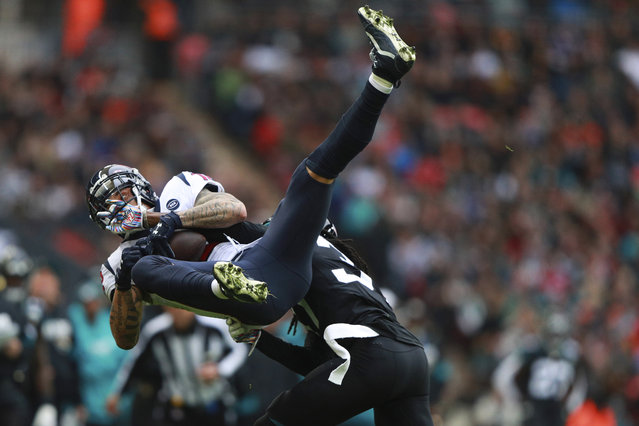 Jacksonville Jaguars cornerback Tre Herndon (37) hits Houston Texans wide receiver Kenny Stills (12) during the first half of an NFL football game at Wembley Stadium, Sunday, November 3, 2019, in London. (Photo by Ian Walton/AP Photo)