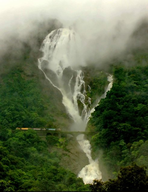 """""""Sea of Milk"""". This Waterfall is a massive Waterfall. It is a tiered waterfall located on the Mandovi River on the Goa-Karnataka border, India, 60 km from Panaji. This is India's 5th tallest waterfall, and 227th in the world with a height of 310 m (1017 Feet) and average Width of 30 meters (100 Feet). In Monsoon, the water plummets hundreds of feet in large volumes forming one of the most spectacular natural phenomenon. Photo location: Goa-Karnataka Border, Goa, India. (Photo and caption by Sandeep Bharat/National Geographic Photo Contest)"""