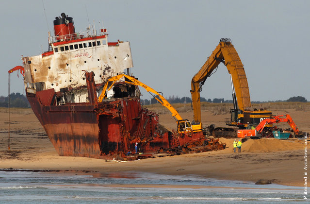 The bow removed, crews continue work to dismantle the TK Bremen, on Kerminihy beach, on January 13, 2012