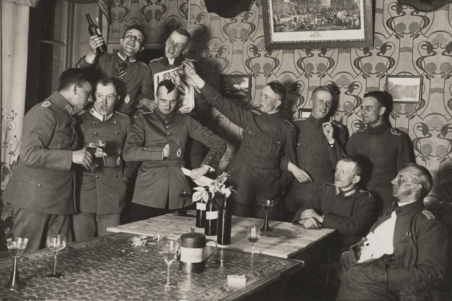 German officers of Flieger Abteilung 280 have a party at a house where they are stationed near the Western Front, in this 1918 handout picture. This picture is part of a previously unpublished set of World War One (WWI) images from a private collection. The pictures offer an unusual view of varied and contrasting aspects of the conflict, from high tech artillery to mobile pigeon lofts, and from officers partying in their headquarters to the grim reality of life and death in the trenches. The year 2014 marks the centenary of the start of the war. (Photo by Reuters/Archive of Modern Conflict London)
