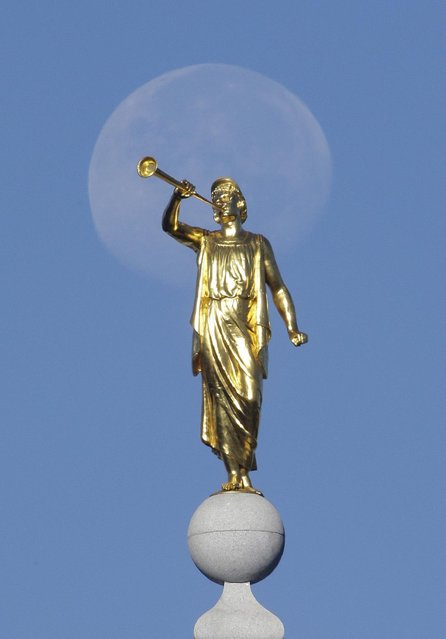 In this September 11, 2014, file photo, the angel Moroni statue sits atop the Salt Lake Temple, at Temple Square, in Salt Lake City. (Photo by Rick Bowmer/AP Photo)