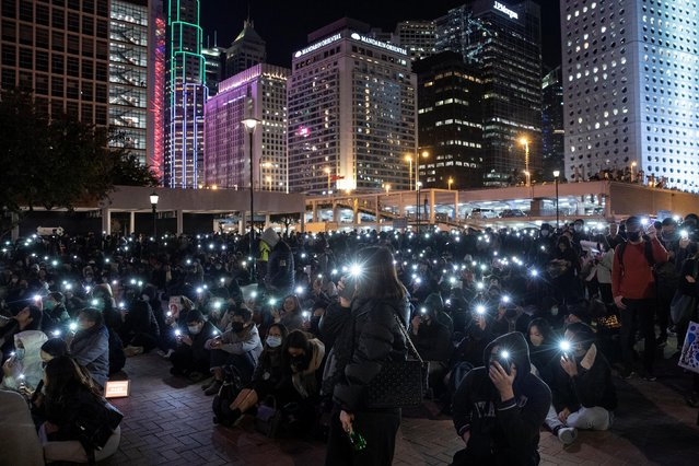 """Anti-government protesters hold up their lit-up mobile phones as they attend a """"say no to tear gas"""" rally in Hong Kong, December 6, 2019. (Photo by Danish Siddiqui/Reuters)"""