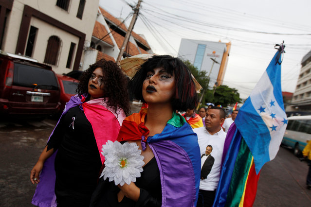 Members of the LGBT community march toward the U.S. Embassy during a vigil in memory of the victims of the Orlando Pulse gay nightclub shooting, in Tegucigalpa, Honduras, June 16, 2016. (Photo by Jorge Cabrera/Reuters)
