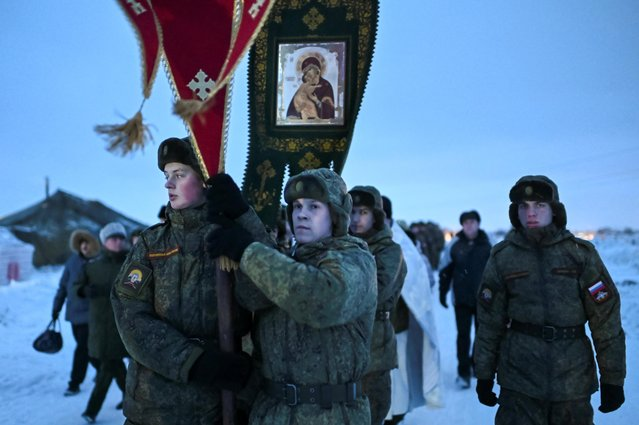 Cadets of Automotive Armored Engineering Institute take part in a procession during celebrations of the Orthodox Christian feast of Epiphany in Omsk, Russia on January 19, 2020. (Photo by Alexey Malgavko/Reuters)