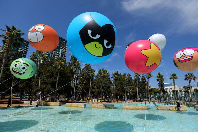 Workers set up balloons for  The Cartoon Network prior to the opening preview night  at Comic Con International in San Diego,California, U.S., July 19, 2017. (Photo by Mike Blake/Reuters)