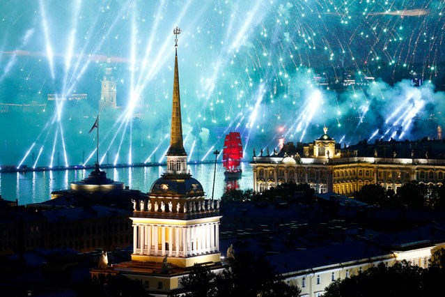Fireworks are seen over the Admiralty building, the Peter and Paul cathedral and the State Hermitage museum during the festivities marking school graduation in St. Petersburg, Russia June 24, 2018. (Photo by Anton Vaganov/Reuters)