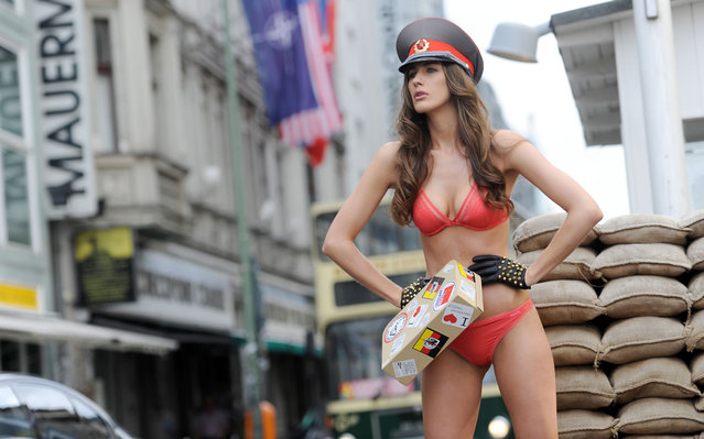 A model poses at Checkpoint Charlie, a historic place in the German capital to promote the fashion magazine Sous on June 12, 2012