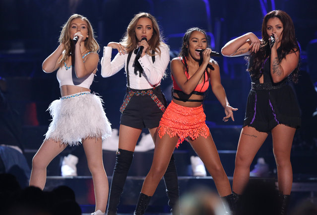 "Perrie Edwards, from left, Jade Thirlwall, Leigh-Anne Pinnock and Jesy Nelson of the group ""Little Mix"" perform at the Teen Choice Awards at the Galen Center on Sunday, August 16, 2015, in Los Angeles. (Photo by Matt Sayles/Invision/AP Photo)"