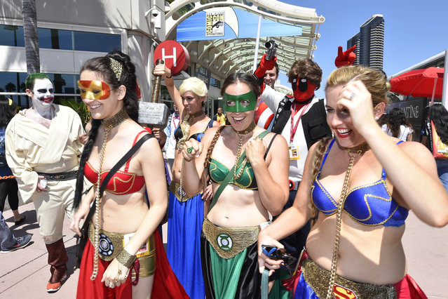 Costumed characters walk outside of the convention center on day 1 of the 2014 Comic-Con International Convention held Thursday, July 24, 2014 in San Diego. (Photo by Denis Poroy/Invision/AP Photo)