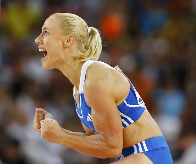Nikoleta Kyriakopoulou of Greece reacts as she competes in the women's pole vault final during the 15th IAAF World Championships at the National Stadium in Beijing, China, August 26, 2015. (Photo by Kai Pfaffenbach/Reuters)