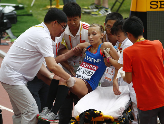 Mayada Al-Sayed of the Palestinian Territories receives medical assistance after finishing the women's marathon at the 15th IAAF Championships in Beijing, China August 30, 2015. (Photo by David Gray/Reuters)