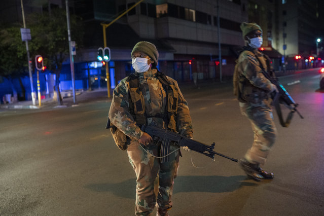 South African Defense Forces patrol downtown Johannesburg, South Africa, Friday, March 27, 2020. (Photo by Jerome Delay/AP Photo)