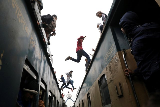People jump between trains, who has come to attend at the final prayer of Bishwa Ijtema, which is considered the world's second-largest Muslim gathering after Haj, in Tongi, outskirts of Dhaka, Bangladesh, January 12, 2020. (Photo by Mohammad Ponir Hossain/Reuters)