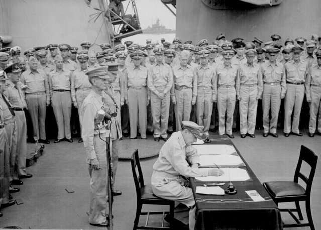 General Douglas MacArthur signs as Supreme Allied Commander during Japan's formal surrender ceremonies on the battleship USS Missouri in Tokyo Bay in a September 2, 1945 file photo. (Photo by Lt. C. F. Wheeler/Reuters/US Navy)
