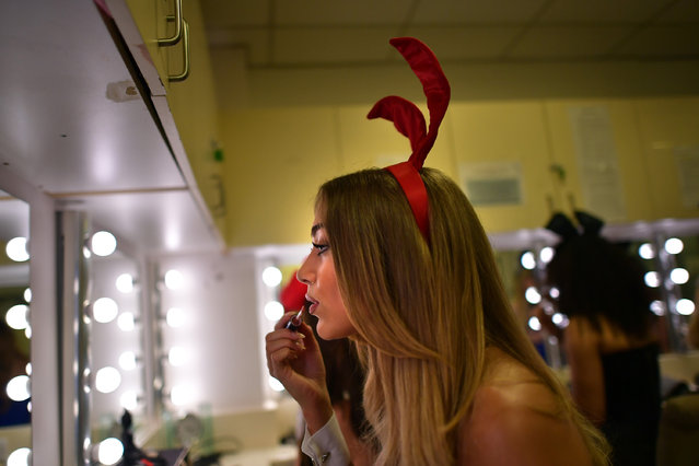 Playboy Bunny, Penny (surname not given), applies make-up as she prepares herself before starting work at the Playboy Club on July 26, 2016 in London, England. (Photo by Carl Court/Getty Images)