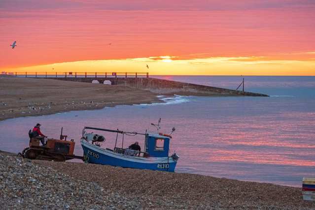 A vivid sky greeted a fishing boat in Hastings, United Kingdom  yesterday, on April 3, 2020. Temperatures will hit 19C tomorrow. (Photo by Carolyn Clarke/Alamy Live News)