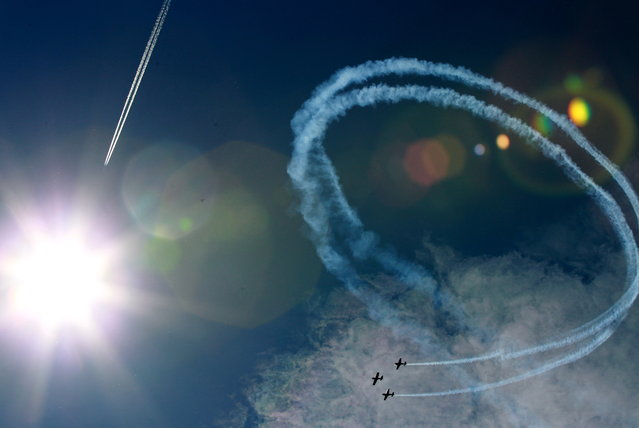 "Aerobatic group ""FireBirds"" from Poland performs during an airshow in Nowy Targ, Tatra Region, Poland, August 17, 2014. (Photo by Grzegorz Momot/EPA)"