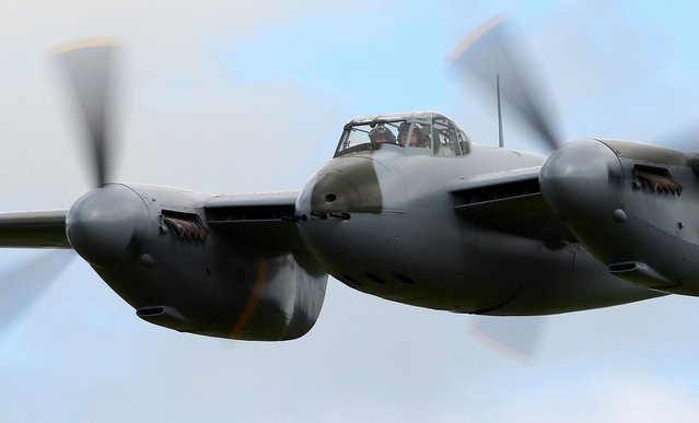 Havilland Mosquito KA 114 performs a low pass during an airshow commemorating the completion of its rebuild on September 29, 2012 in Ardmore, New Zealand. The plane was restored by Warbird Restorations at Ardmore Aerodrome and is the only flying Mosquito in the world.  (Photo by Simon Watts)