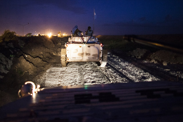 The Indian Battalion of the United Nations Peacekeepers patrols the perimeter of the Protection of Civilians (POC) site and the United Nations Mission in South Sudan (UNMISS) compound during a night patrol in Malakal, South Sudan on Monday, July 11, 2016. The UN has assured the displaced people that increased security measures around the camp will protect them from any further attack. Most of the displace are not convinced. The Malakal POC site houses over 32,000 displaced people mainly from the Shilluk and Nuer tribes. In February of this year, members of the Dinka tribe, who resided in the camp at the time, carried out a coordinated attack within the site leading to the destruction of hundreds of shelters and many deaths. Since then, most members of the Dinka tribe have fled to Malakal town where they occupy the homes of those still displaced. (Photo by Jane Hahn/The Washington Post)