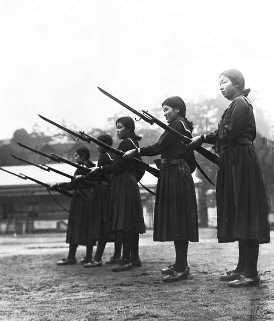 Young women learn how to charge an enemy with rifles and bayonets at their high school in Tokyo, February 18, 1937. Japan trained women and girls for auxiliary army units. (Photo by AP Photo)