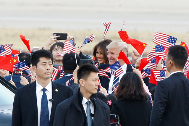U.S. President Donald Trump and first lady Melania Trump arrive at Beijing airport, China, November 8, 2017. (Photo by Thomas Peter/Reuters)