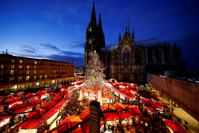 A general view of the Christmas market on the square in front of the world famous gothic cathedral in Cologne, Germany, November 28, 2017. (Photo by Thilo Schmuelgen/Reuters)