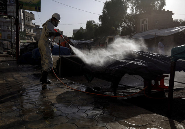 A Yemeni worker sprays disinfectant at an empty market during the emergency lockdown of some areas due to the ongoing COVID-19 pandemic, in Sanaa, Yemen, 06 May 2020. According to media reports, the Houthi authorities have announced a one-day curfew in ten neighborhoods of the capital Sanaa as a measure to curb widespread of the SARS-CoV-2 coronavirus which causes the COVID-19 disease. (Photo by Yahya Arhab/EPA/EFE/Rex Features/Shutterstock)