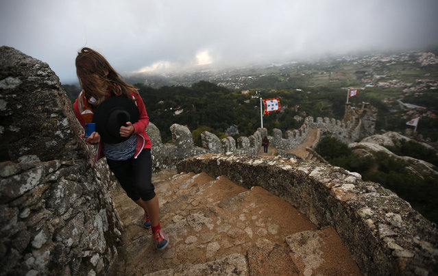 A visitor walks by the wall at the Moorish Castle in Sintra October 8, 2014. (Photo by Rafael Marchante/Reuters)