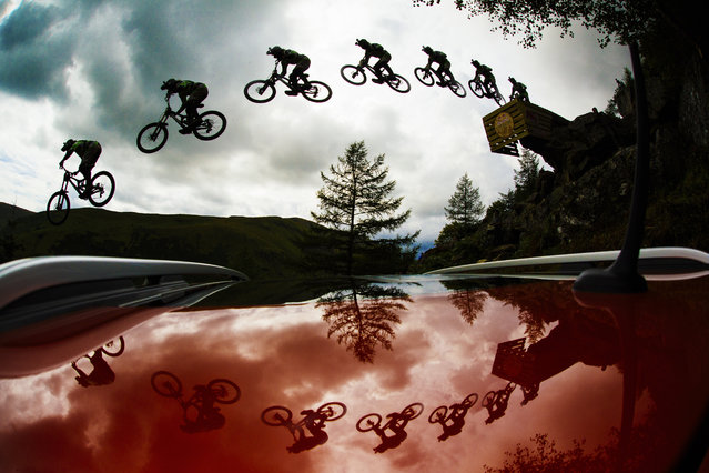 Participant jumps the road gap at the Red Bull Hardline in Dinas Mawddwy, United Kingdom. (Photo by Duncan Philpott/Red Bull/SWNS.com)