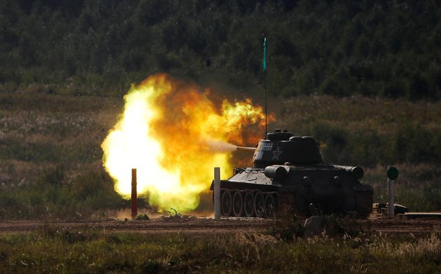 "A T-34-85 tank fires during a demonstration at the International military-technical forum ""Army-2020"" at Alabino range in Moscow Region, Russia, August 23, 2020. (Photo by Maxim Shemetov/Reuters)"