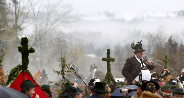 A farmer dressed in a traditional Bavarian costume stands in a wooden carriage during the Leonhard procession in Bad Toelz November 6, 2014. (Photo by Michaela Rehle/Reuters)