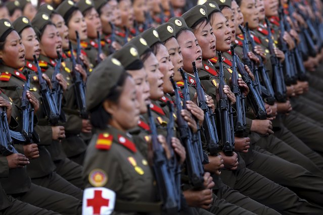 Soldiers shout slogans under the stands with North Korean leader Kim Jong Un and other officials during the parade celebrating the 70th anniversary of the founding of the ruling Workers' Party of Korea, in Pyongyang October 10, 2015. (Photo by Damir Sagolj/Reuters)