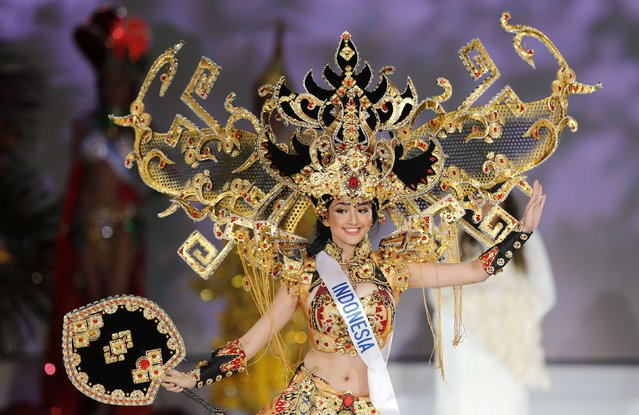 """Elfin Pertiwi Rappa representing Indonesia poses in a national costume during the 54th Miss International beauty pageant in Tokyo November 11, 2014. Rappa won in the """"Best National Costume"""" category. (Photo by Thomas Peter/Reuters)"""