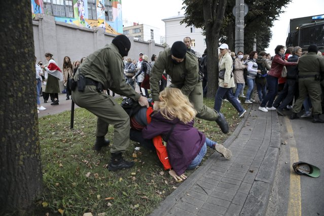 Police officers detain a woman during a rally in support of Maria Kolesnikova, a member of the Coordination Council created by the opposition to facilitate talks with Lukashenko on a transition of power, was detained Monday in the capital of Minsk with two other council members, in Minsk, Belarus, Tuesday, September 8, 2020. A leading opposition activist in Belarus is being held on the border with Ukraine after she resisted attempts by authorities to deport her from the country as part of a clampdown on protests against authoritarian President Alexander Lukashenko. (Photo by AP Photo/Stringer)