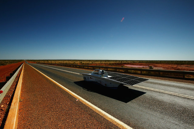 Magalux of GAMF Hungary crosses the Ghan overpass as it races in the Challenger Class during day two of the 2015 World Solar Challenge on October 19, 2015 near Wycliffe Well, Australia. Teams from across the globe are competing in the 2015 World Solar Challenge - a 3000 km solar-powered vehicle race between Darwin and Adelaide. (Photo by Mark Kolbe/Getty Images for The World Solar Challange)